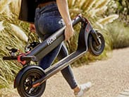 Woman holding Flow Electric Scooters
